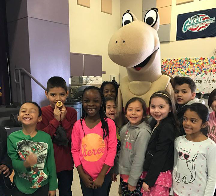 Group of happy school children with Mojave Max mascot